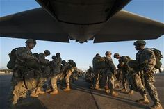 U.S. Army paratroopers from the 82nd Airborne Division perform an equipment check before boarding a C-130H Aug. 18, 2013, at Alexandria International Airport, La. The paratroopers were conducting a static line drop that marked the beginning of Joint Operational Access Exercise 13-0X. (U.S. Air Force photo/Staff Sgt. Russ Scalf)