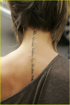 word tattoos for center of back | Posh's Neck Tattoo | posh back tattoo 11 - Photo Gallery | Just Jared