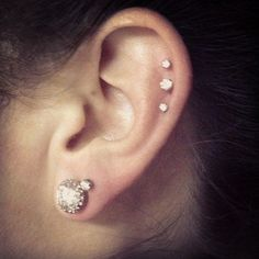I want something like this I think...or triple forward helix but then I also want my tragus and took or something done too...30 Cute and Different Ear Piercings - Sortrature
