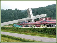 FAKE - Image Showing Giant Cross Crashed Through Adult Store Roof: The image is photoshopped. Both the giant cross and the adult store are real, but the cross did not fall through the roof of the store. A local preacher named James Potter put up the cross, which stands on a roadside at Caryville, Tennessee in close proximity to the Adult World store.