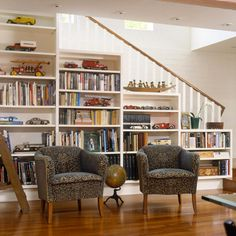 Stair-Step Bookshelf  Be creative when selecting storage areas. Rather than turning automatically to built-in cabinets, consider using the space along the stairs, beside a knee wall, or between wall studs. Staggered bookshelves mimic the height of this staircase, creating a home library without an obtrusive appearance.
