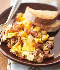 Bacon, Ham and Egg Hash: A simple, hearty brunch. Make with bacon, ham, cheese, potatoes and eggs!
