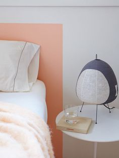 Painted wall headboard. Love the simplicity!