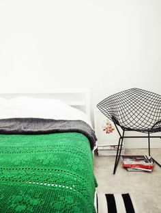 love the bright green blanket. the color's great and even the granny style knitting goes okay with the diamond chair and modern bed