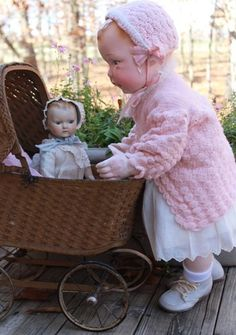 """26"""" antique store mannequin, dressed in vintage infant clothes. Shown with antique baby doll and carriage. Unknown circa."""