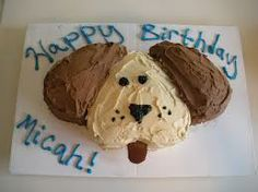 Dog cake made from 2 heart-shaped cake pans.