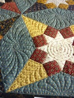 feather quilting in various shaped blocks