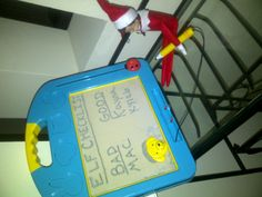 """Elf on the Shelf: Tonight our Elf found our magnet board and made a """"mid-way"""" Progress Report. So far the kids are both doing well, but the dog (Mac) is on the bad list. ;)"""