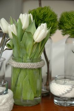 White tulips. glass jar with knitted ring