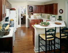 This kitchen is centered between the dining and breakfast rooms. The Hampton - 390. http://www.dongardner.com/plan_details.aspx?pid=343. #Kitchen #Home #Design