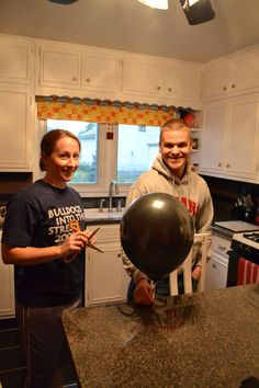 Gender Reveal: Fill dark balloon with blue or pink confetti. Pop balloon to reveal if it's a boy or girl!