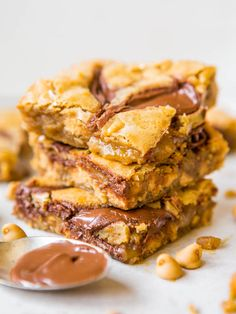 Nutella-Swirled Peanut Butter Chip Blondies - One bowl, no mixer, soft & gooey! Peanut Butter & Nutella is always a win & these are so easy!