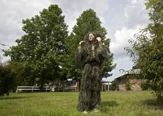 Tommy Rudolph, 10, adjusts his Ghillie Suit as traffic passes on Bruton Avenue on Thursday in Newport News. Rudolf, a fan of airsoft games, said he wanted to test the suit for the first time after receiving it by mail. (Photo by Kaitlin McKeown / Daily Press)