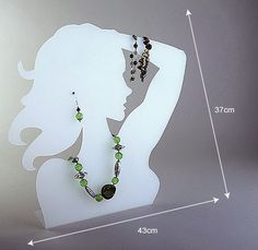 interesting display piece for necklace + bracelet + earrings sets