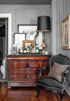 Burl Wood Console, Black French Provincial Chair, and Leopard Pillow. Masculine Room.