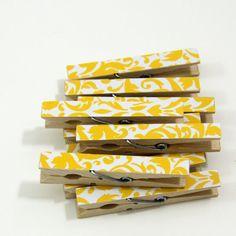 clothes pins + scrapbook paper?