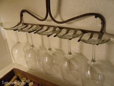 Find an old rake to make a wine glass rack!