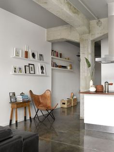 love the cement & angled doorways