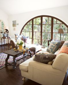 Joey and Gerard's France Meets California Mountain Cottage House Tour | Apartment Therapy ... love this huge arched window!