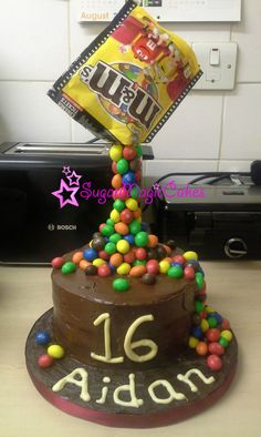 My sons 16th birthday cake! Gravity defying m & m cake, mmmmmmm!!! HAPPY BIRTHDAY AIDAN XX