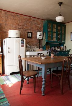The lighthouse's kitchen. Along with some lovely wooden cafe chairs, the room features a beautiful sink and an ancient General Electric refrigerator, still in tip-top working condition! They just don't make 'em like they used to, I guess!