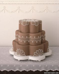 What about a different shape for just bottom tier & round for others?  Either this scalloped shape or square?
