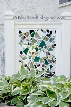Mosaic Screen to hide Air Conditioner. Clever!