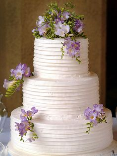 A few sprigs of lavender freesia decorate this three-tier cake.