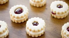 These tender shortbread cookies filled with fluffy marshmallow frosting and raspberry preserves would be great for any special occasion!