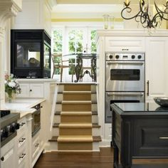 stairs to breakfast nook. OMG!! I am in love.  Love the double oven and the fire place!