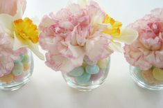 stems can be placed in small water vials (found at any florist shop) and then placed in the candy.