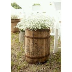 WIne barrel with baby's breath down the aisle