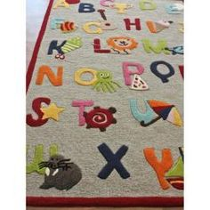 @Overstock - Fun playful pattern and bold colors makes up this fabulous Kids Alphabets and Letters rug. This rug is hand-carved for a bold and unique textured effect featuring shades of yellow, orange, beige, red, green, pink, blue, tan, ivory and brown.http://www.overstock.com/Home-Garden/Hand-carved-Alexa-Kids-Alphabets-Letters-Beige-Wool-Rug-36-x-56/5512543/product.html?CID=214117 $110.99