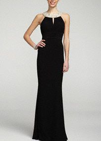 Elegant and timeless, you will shine in this gorgeous jersey dress!  Sleeveless bodice features eye-catching intricate jeweled neckline.  Empire waist helps create a stunning silhouette.  Key hole detail adds a feminine touch to this already fabulous ensemble.  Fully lined. Back zip. Imported poly/spandex blend. Dry clean.