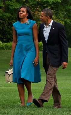 President Obama and First Lady Michelle Obama. I love how he admires her; loves her with his eyes.
