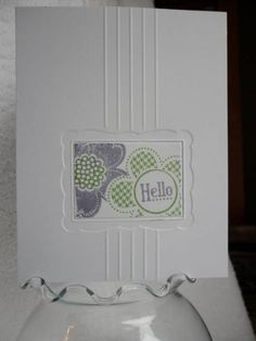 Hello card with scored lines, embossed border and Hello and flower stamped