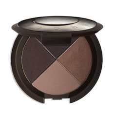 Soft metallic golden coppery shadow all over the lids, with a medium brown shadow blended into the corner of the eyes.  Pair this with a brown liner and mascara. Keep lips nude and skin a bit bronzed.