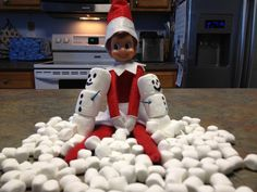 Elf makes marshmallow snowmen because he misses the snow at the North Pole
