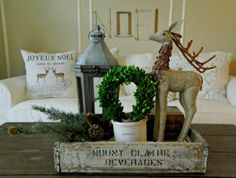 Use an old crate, lantern, books, greenery & reindeer for a simple Christmas tablescape