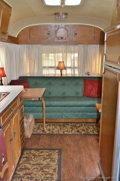 Avion LeGrande travel trailer at a vintage camper rally -- yes, that fancy table leg was standard with the LeGrande package