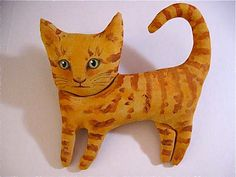 orange cat doll ....... by sandy mastroni    copyright > Sandy Mastroni