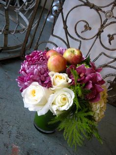 Simple flower arrangement for the fall. Love the apples tucked inside! and who doesn't love a spider mum?!