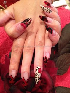 Freehand nail art with 3D bows and 3D flowers Not a fan of the points on the nails but love the design.