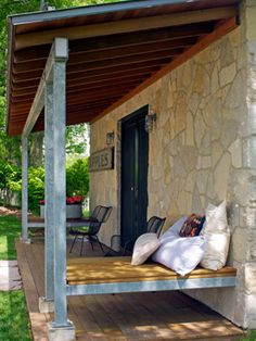 Love the built-in benches on this tiny house's porch.