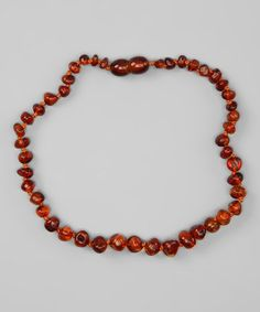 Take a look at this Cognac Round Amber Teething Necklace by Momma Goose on #zulily today!