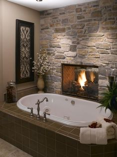 Fireplace between the master bedroom and tub ~ this looks like a very fine place to spend an evening.  I would never stop bathing...