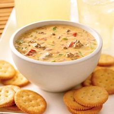 Spicy Cheeseburger Dip (1  lb. (16 oz.)VELVEETA, cut into 1/2-inch cubes 1  can (10 oz.)RO*TEL Diced Tomatoes & Green Chilies, undrained 1  cup shredded low-moisture part-skim mozzarella cheese 1/2  lb.ground beef, cooked, drained 4  green onions, sliced)