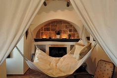 Indoor hammock strategically placed right in front of a fireplace...perfect!