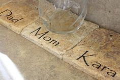Personalized coasters lined up on the kitchen counter to keep track of who has which glass