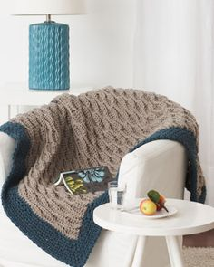 Crocheting into the back loops creates a beautiful and easy waved ridge pattern on this fantastic blanket in Bernat Softee Chunky.